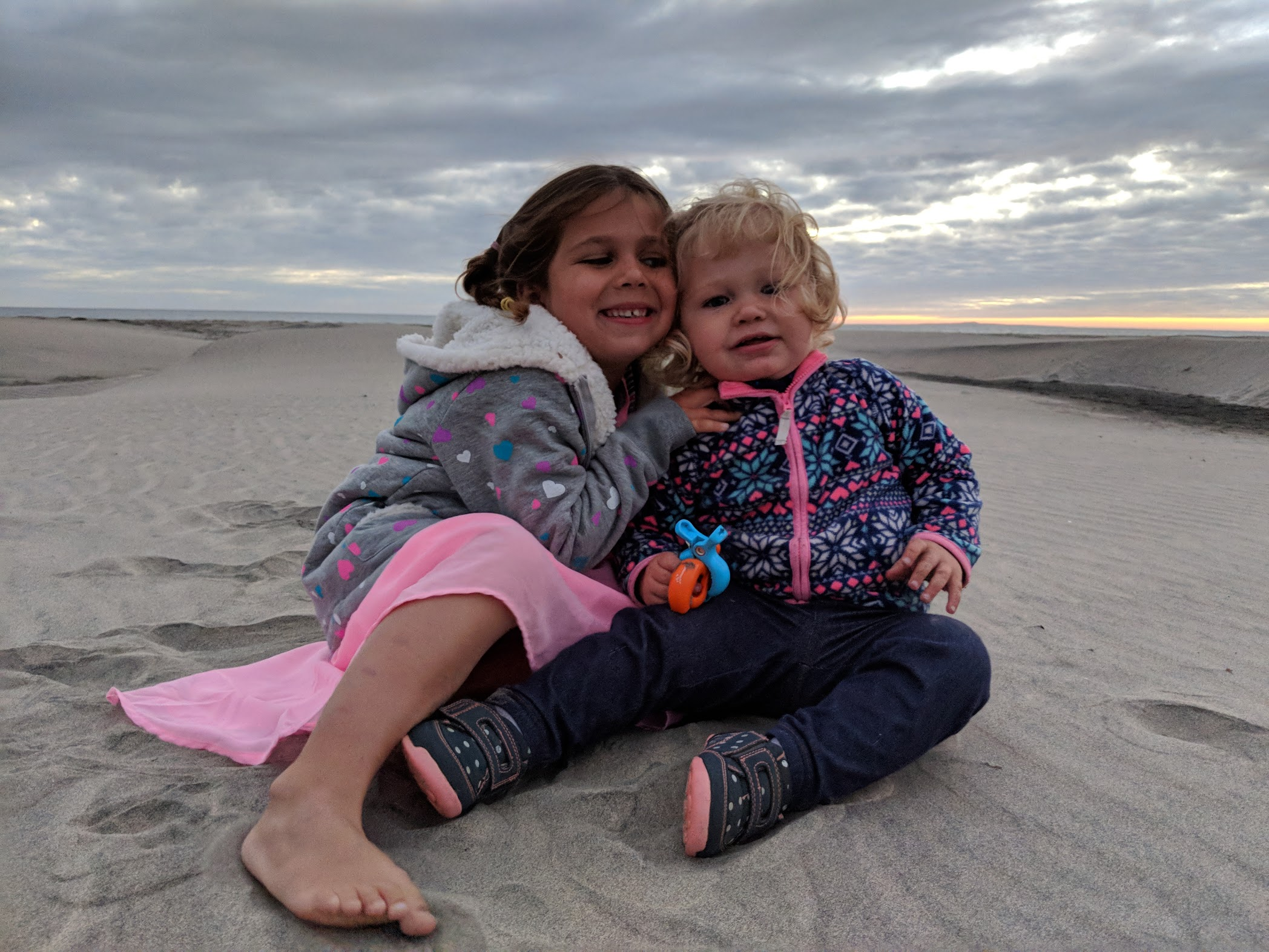 sisters on a sand dune
